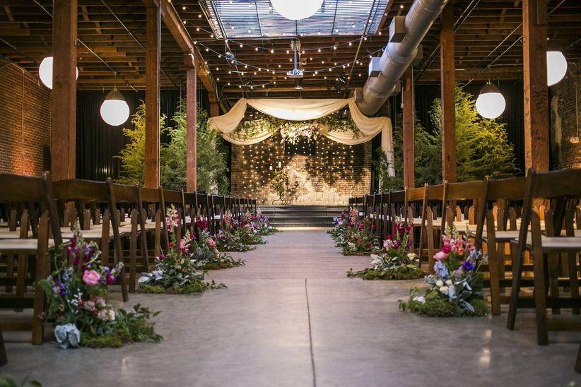 indoor wedding ceremony at warehouse venue