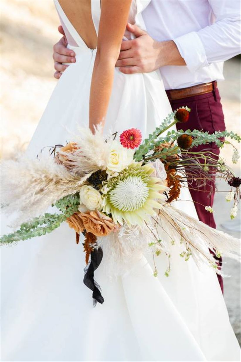 bohemian wedding bouquet with oversized roses, protea and pampas grass
