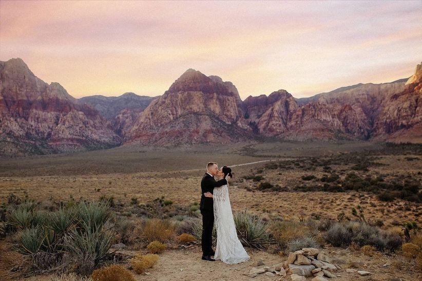 bride and groom posing in las vegas desert canyon
