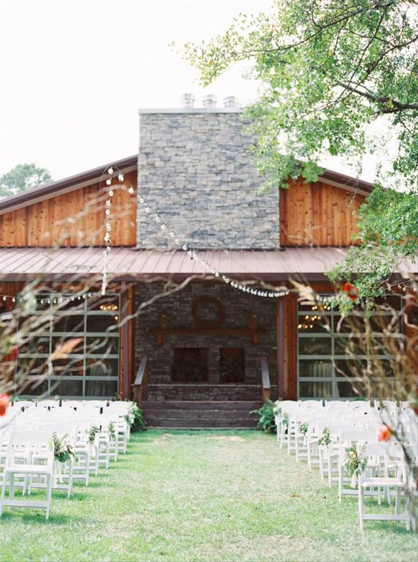 white chairs in garden for outdoor wedding ceremony