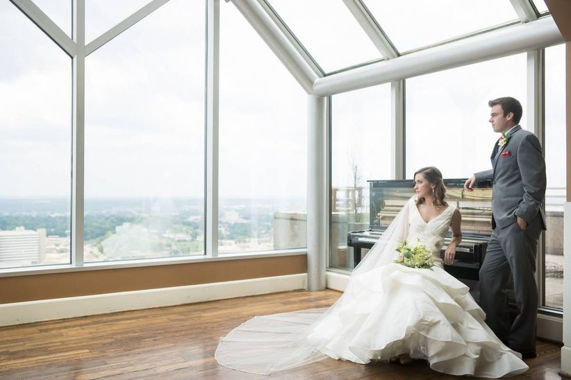 bride and groom pose for wedding portrait in penthouse at City Club of Birmingham, Alabama