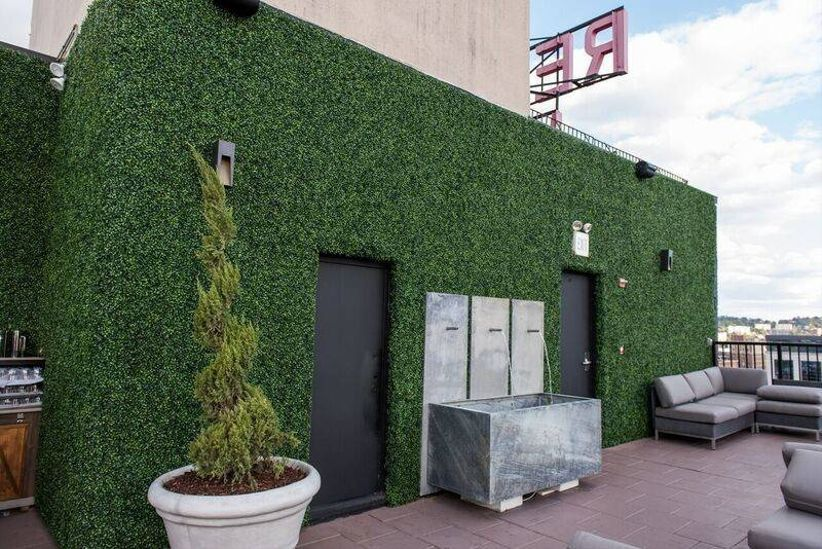 rooftop wedding venue in downtown Birmingham with greenery wall and lounge furniture