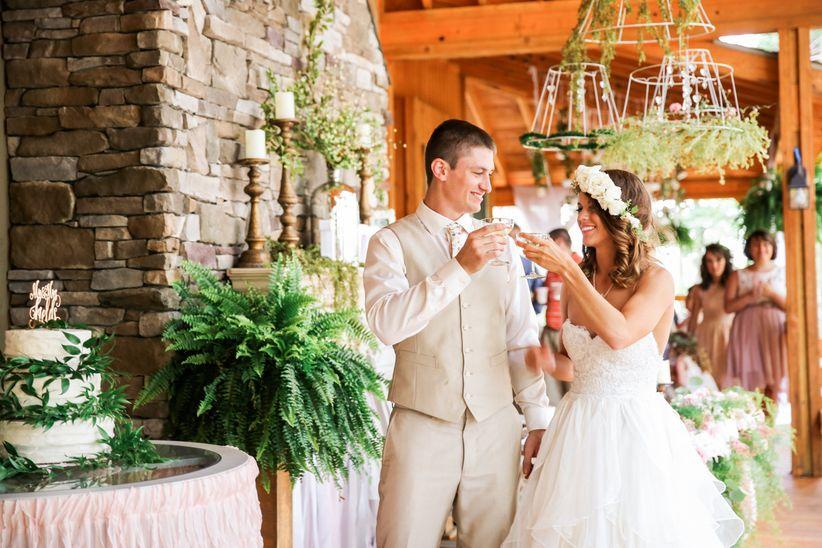 couple toasting wedding reception