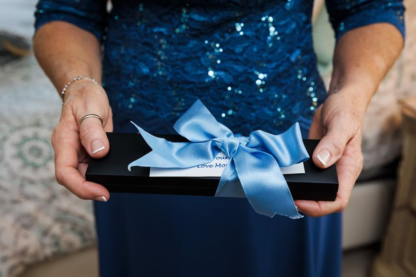mother holding a gift box