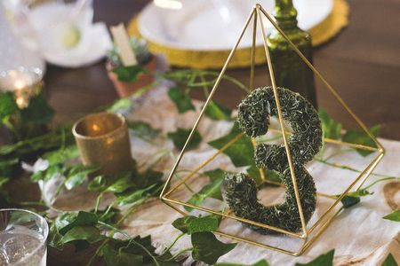 31 Non-Traditional Wedding Table Numbers to Fall in Love With