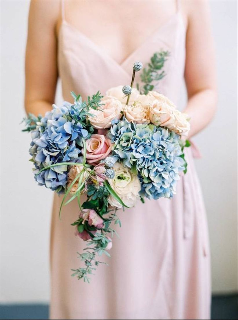 summer wedding bouquet with blue hyrdangeas and pink roses