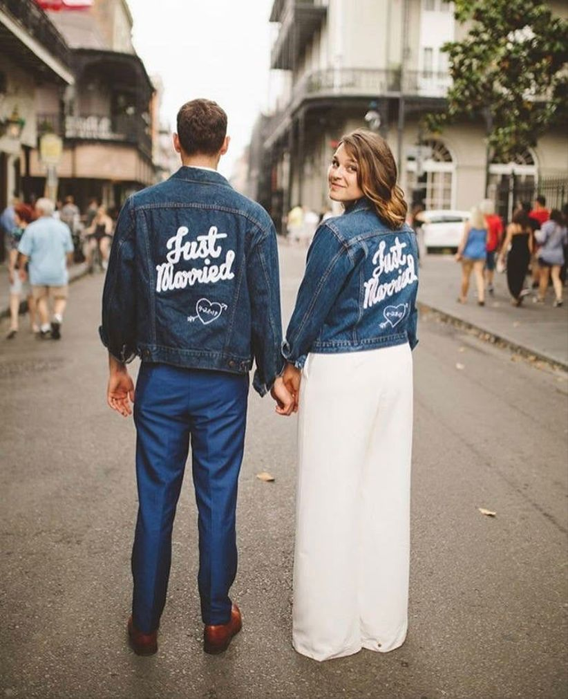 bride and groom hold hands with backs to the camera while wearing matching
