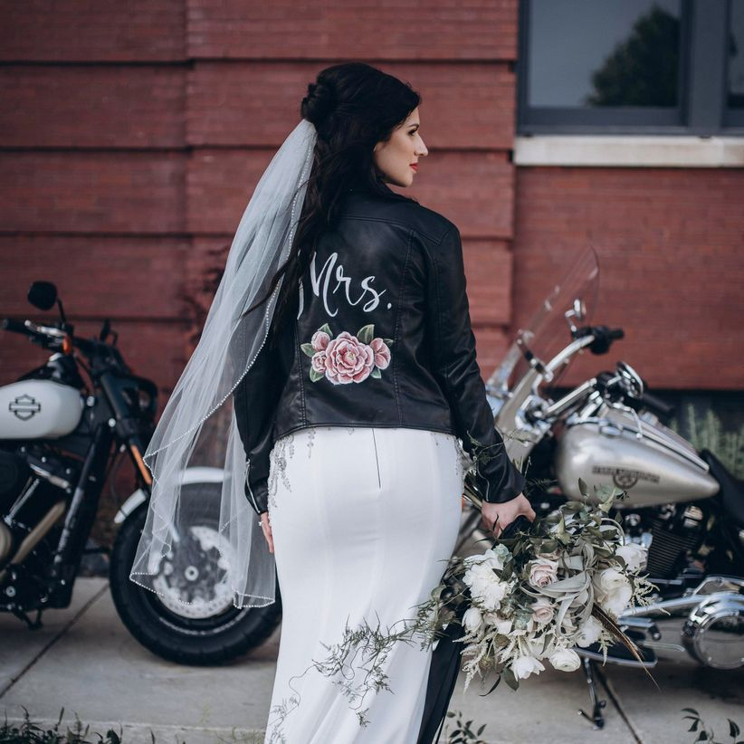 black leather jacket with hand-painted pink rose and