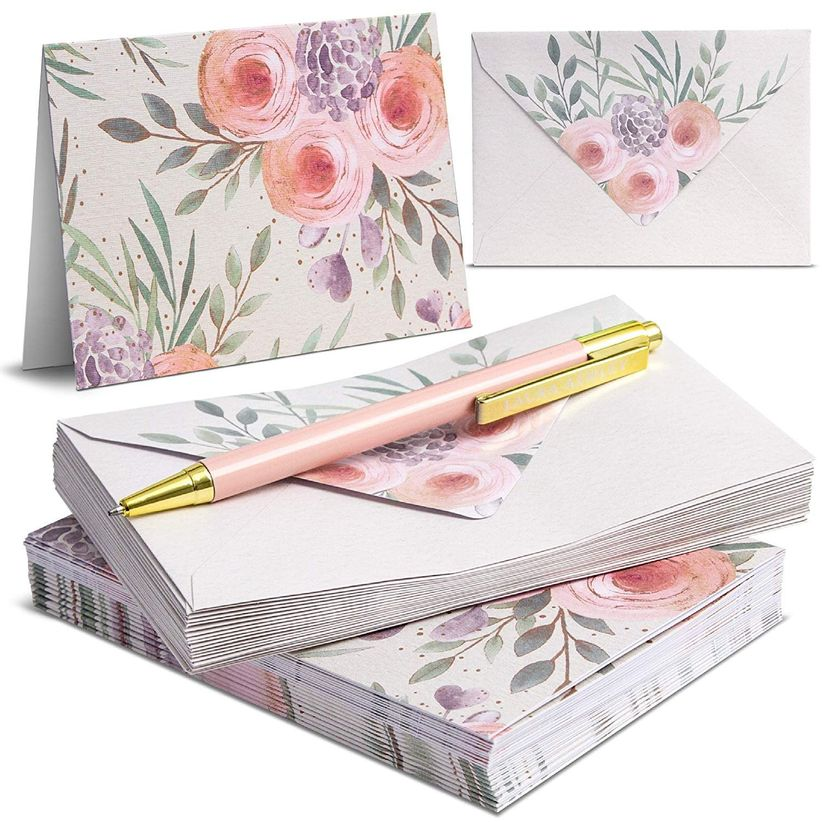 matching stationery set with watercolor blush and green flower pattern on cards, envelopes and pen
