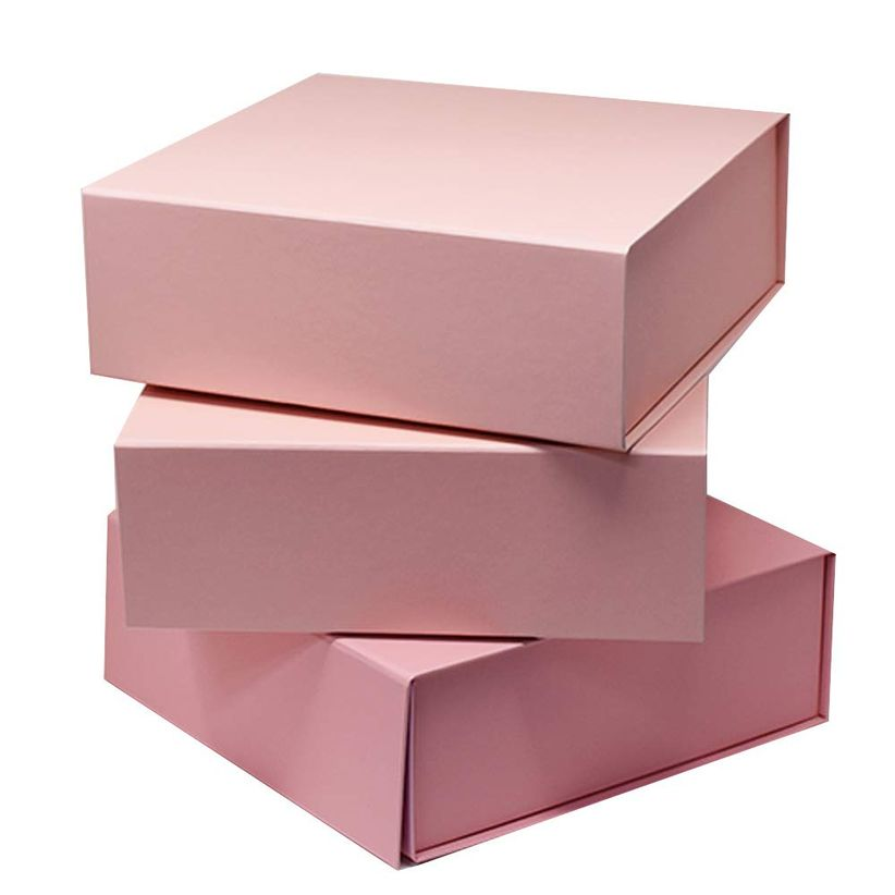 stack of three pink rectangular gift boxes against a white backdrop