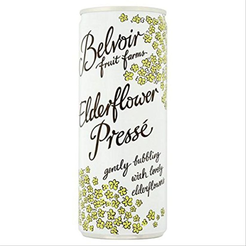 miniature can of sparkling water with black calligraphy and yellow flower details
