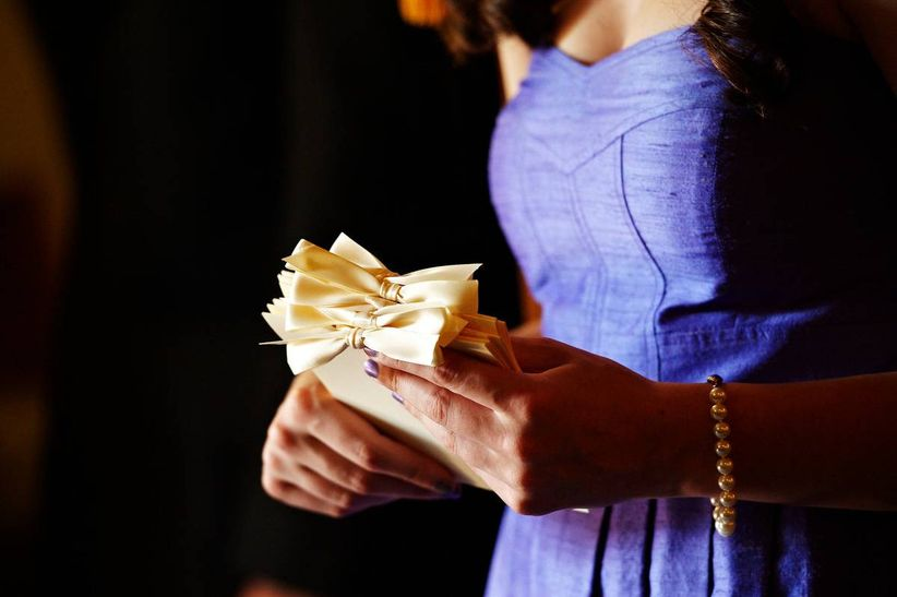 woman holding wedding programs