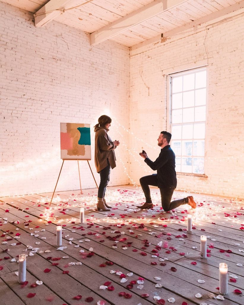 intimate proposal with candles and rose petals