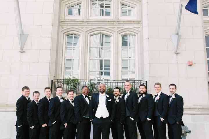 groom and groomsmen black tuxedos outdoor