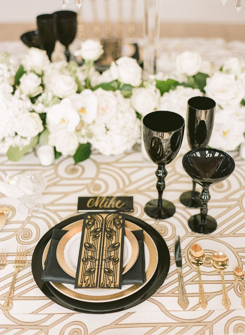 classic wedding place setting with gold and black details