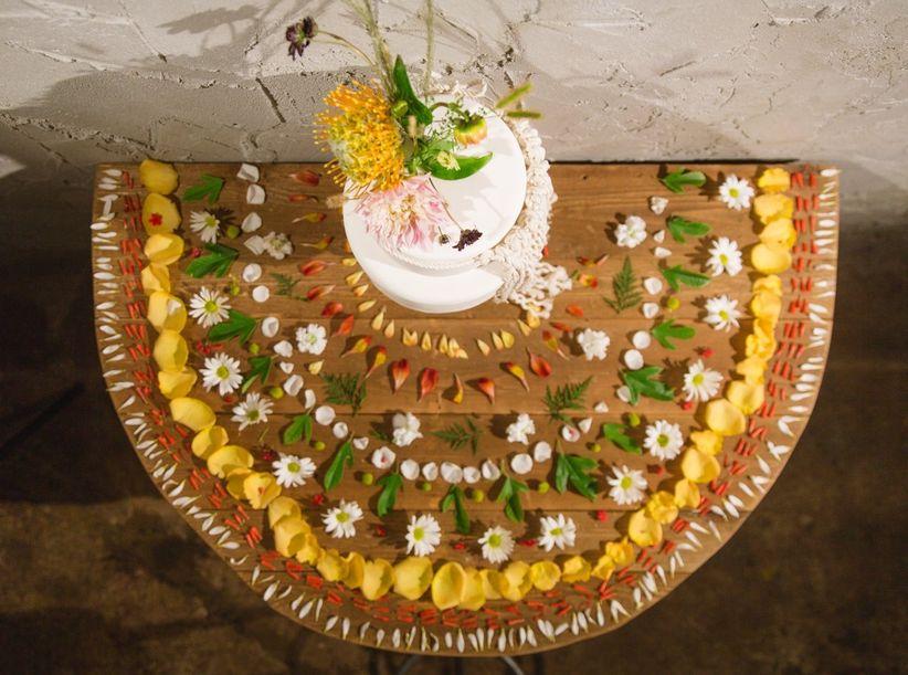 wedding cake table decorated with flower mandala
