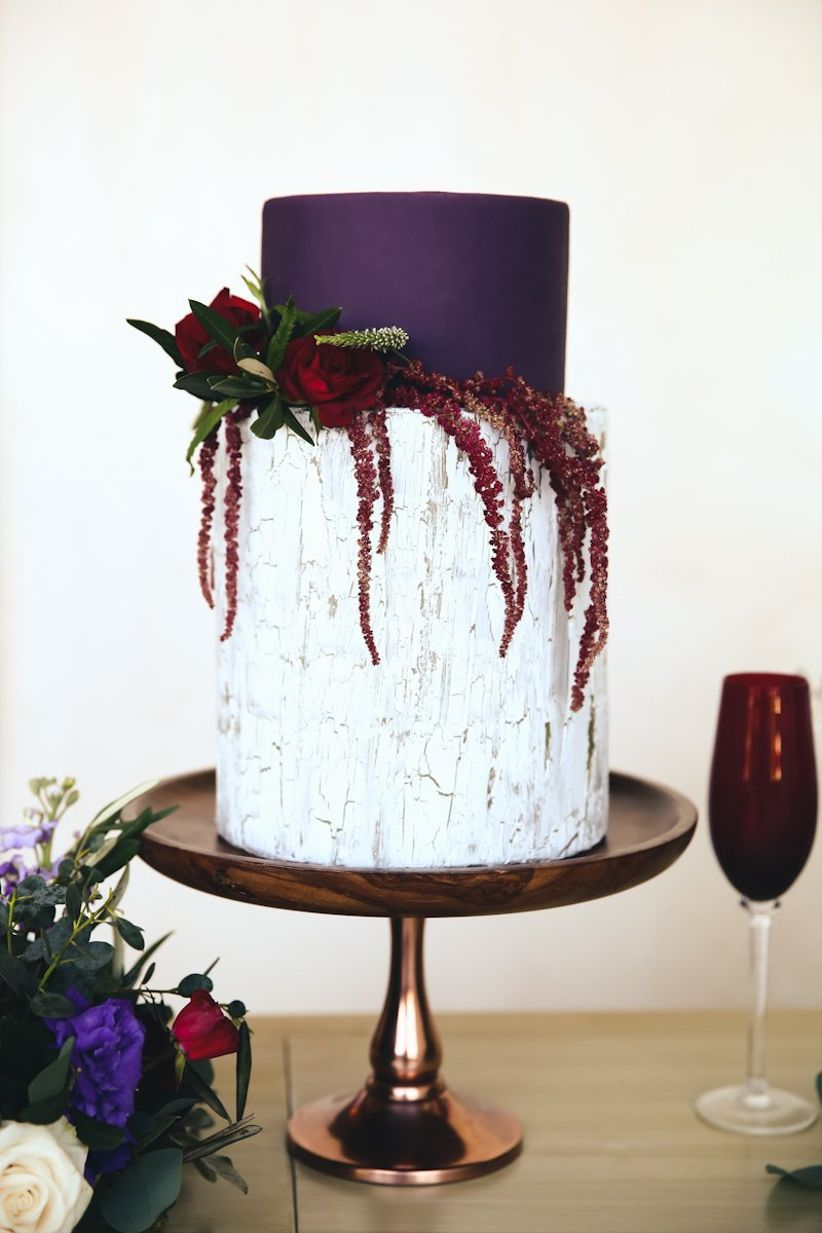 ultra violet purple and white buttercream wedding cake decorated with flowers