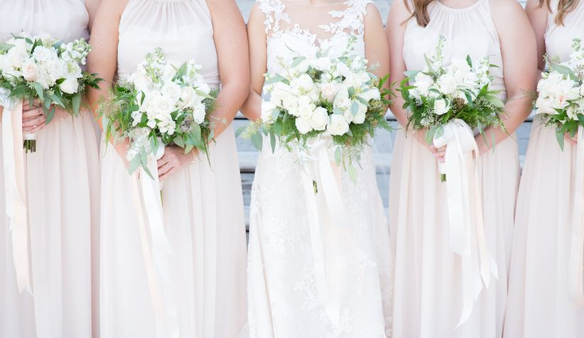spring bridesmaid bouquets with ivory roses and greenery