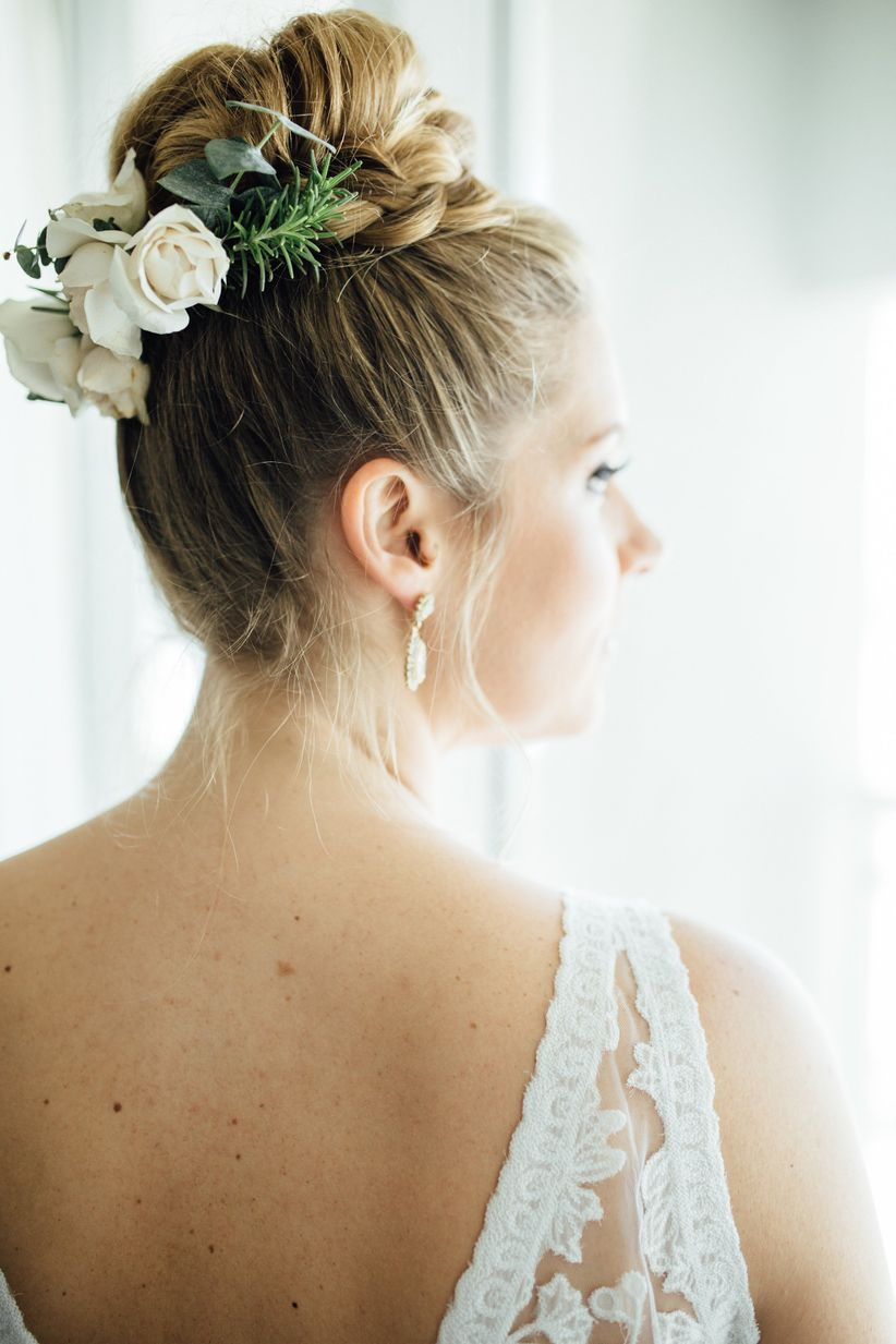 wedding hairstyle for long hair <li>braided bun with flowers