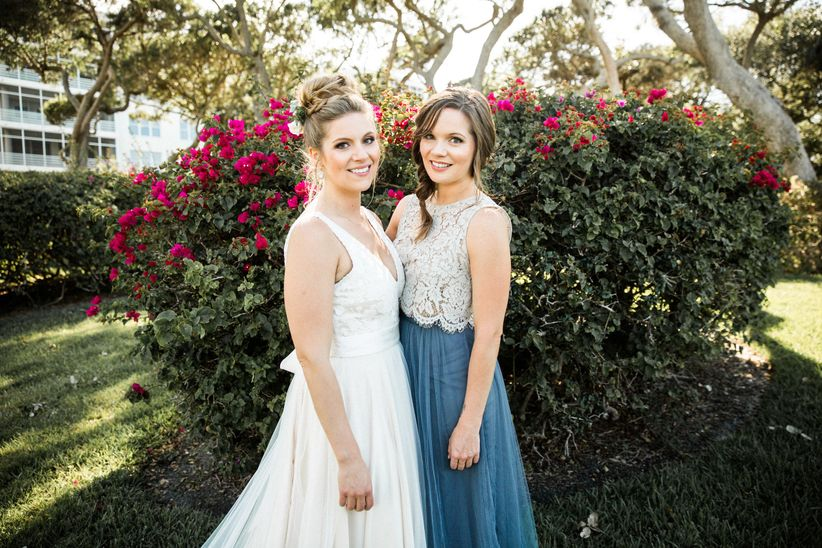 bride in bhldn wedding dress and maid of honor in crop top bridesmaid dress bhldn