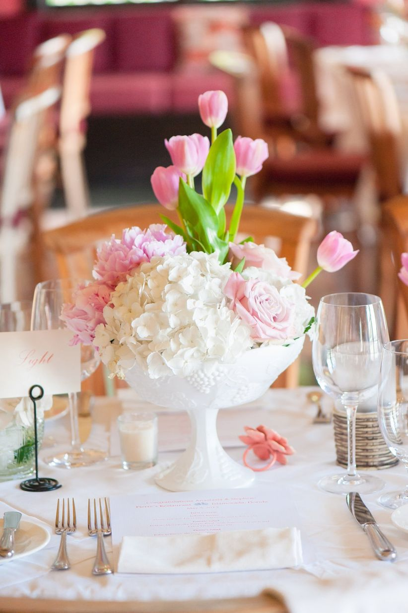 tulip and hydrangea centerpiece with compote vase