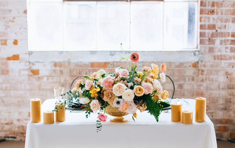 romantic wedding tablescape with blush garden rose centerpiece and candles