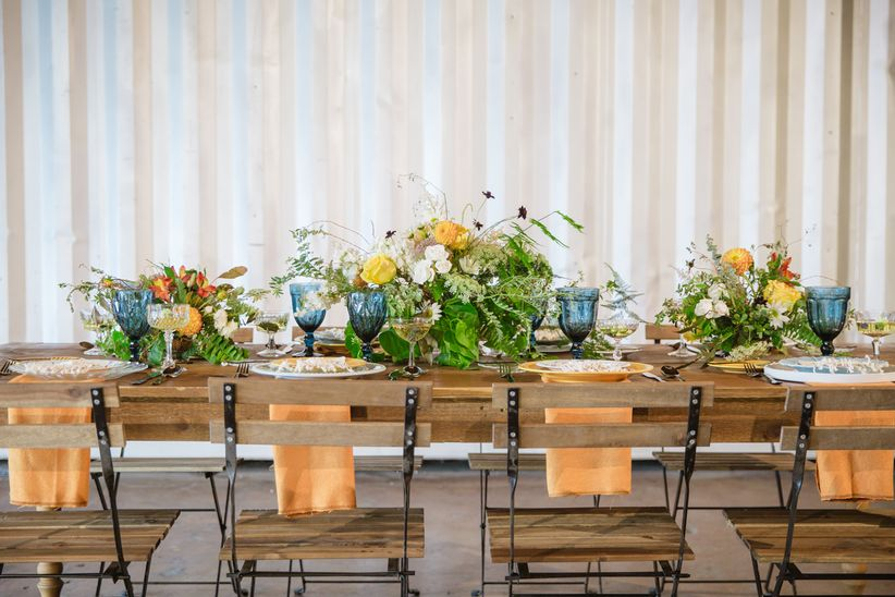 bohemian wedding centerpiece with blue and yellow decor