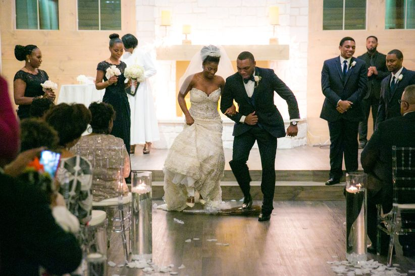 bride groom jumping the broom - new seasons photography
