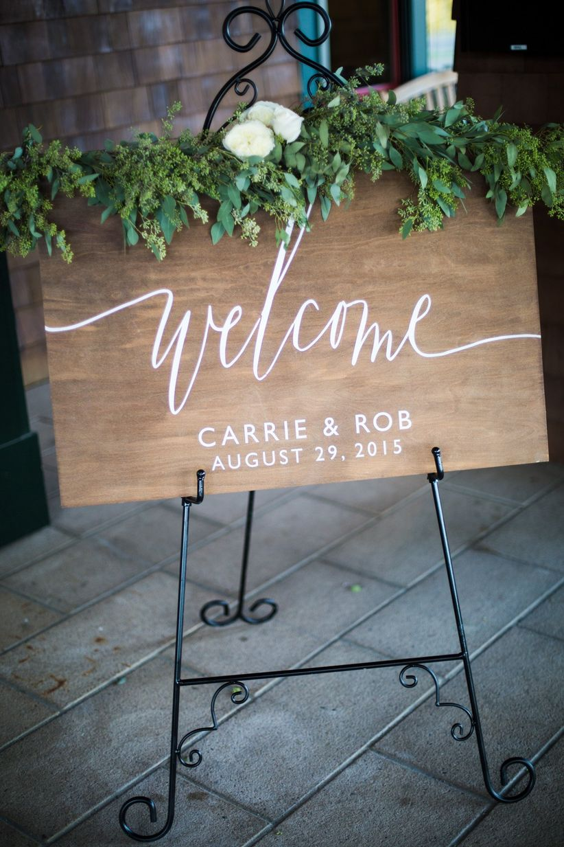 welcome sign with greenery
