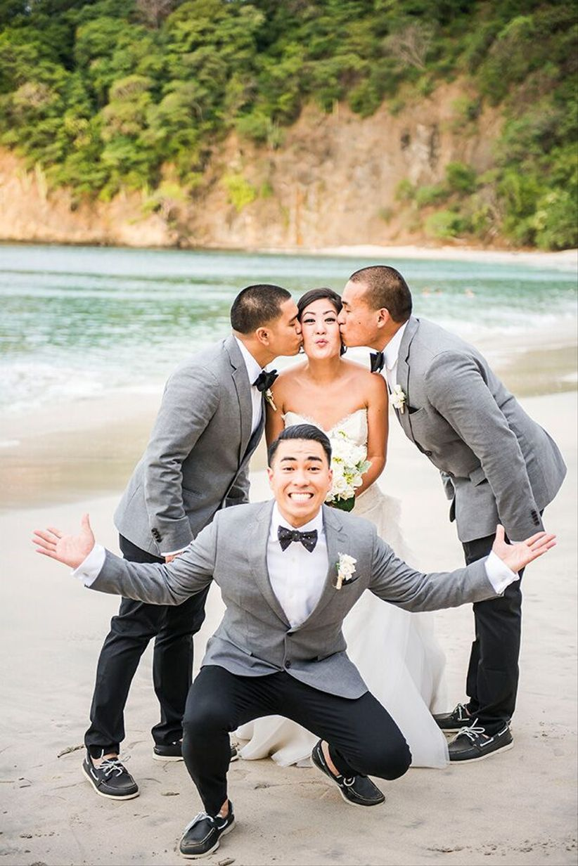 groomsmen kissing bride on the cheek - stories wedding photography costa rica