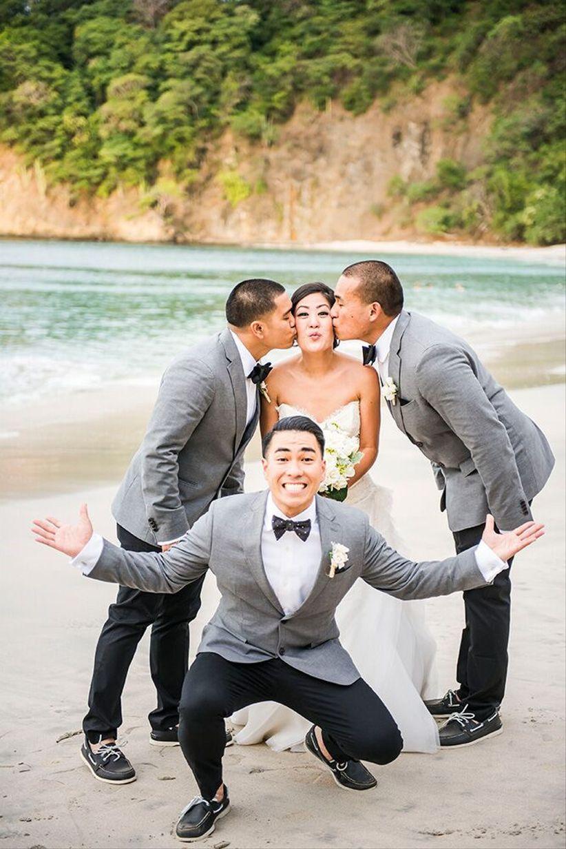 groomsmen kissing bride on the cheek - stories wedding photography costa rica