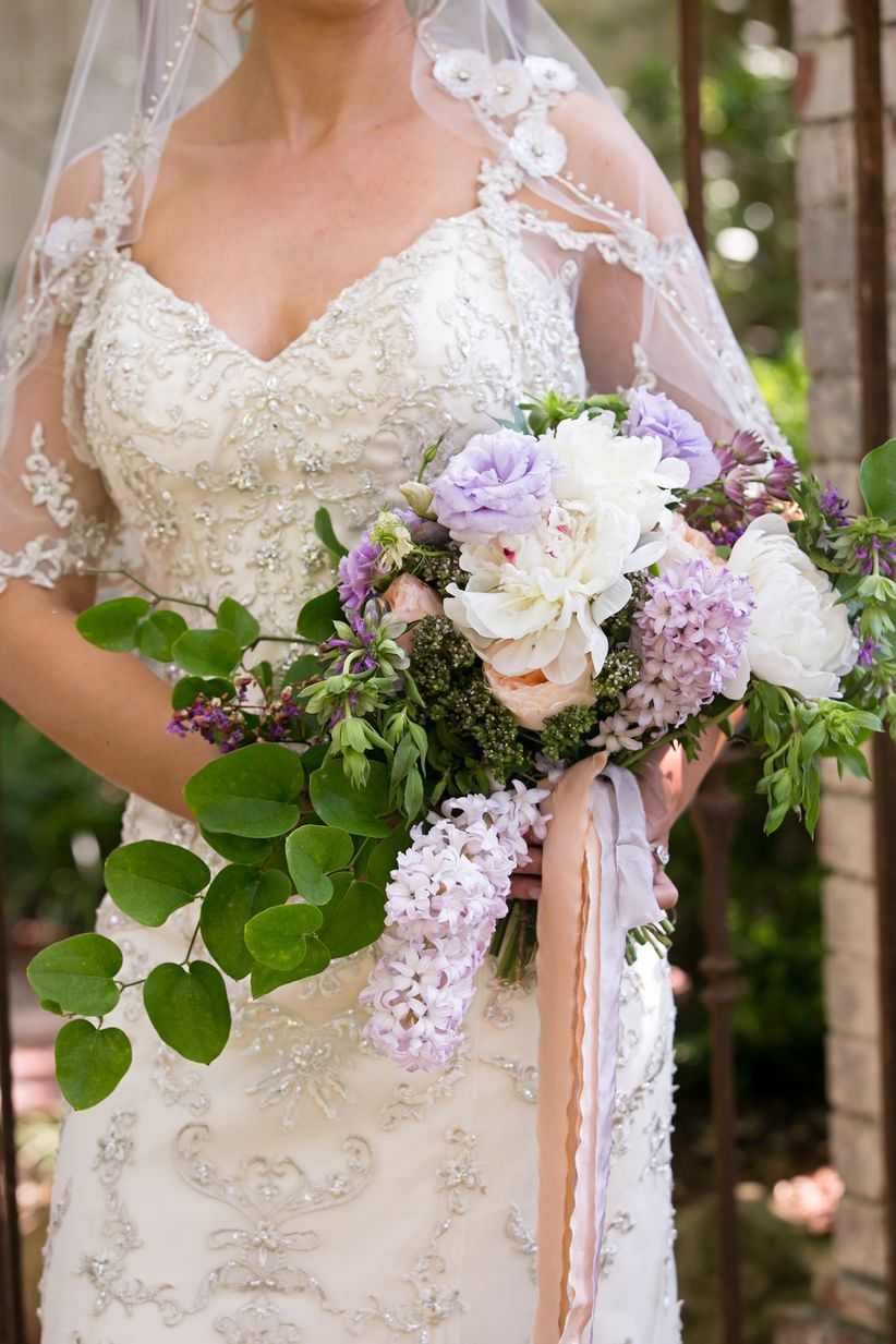purple lisianthus and lilac bouquet with greenery
