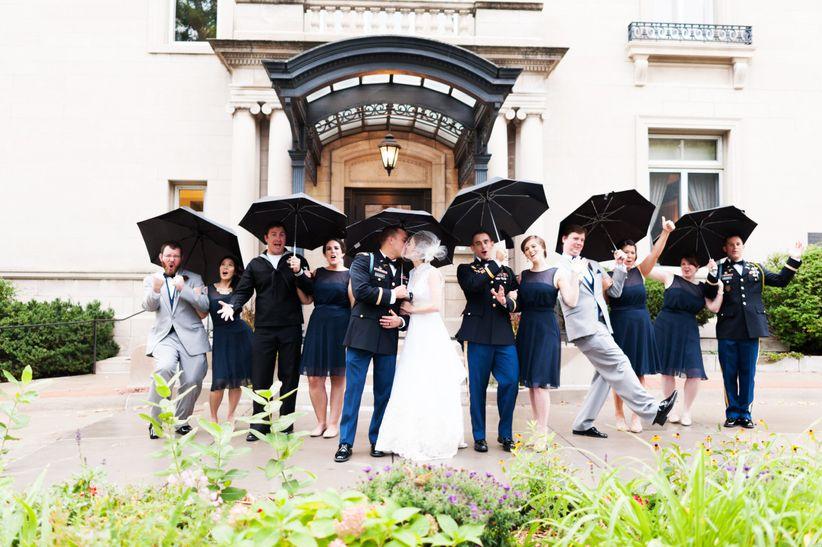 cute wedding party pose with umbrellas