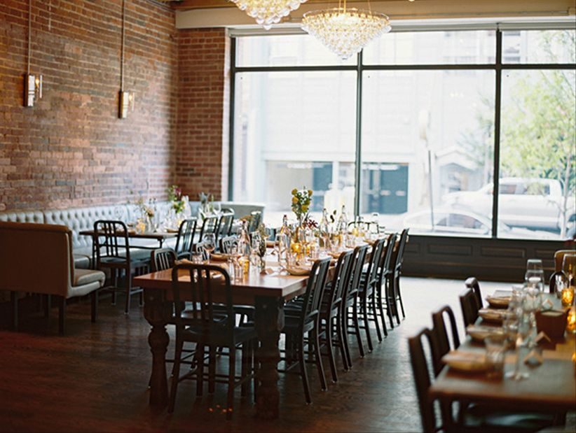 industrial chic modern venue exposed brick rectangle banquet table