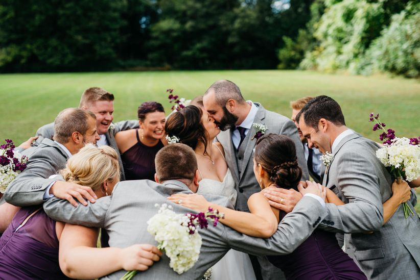wedding party surrounding bride and groom - apaige photography