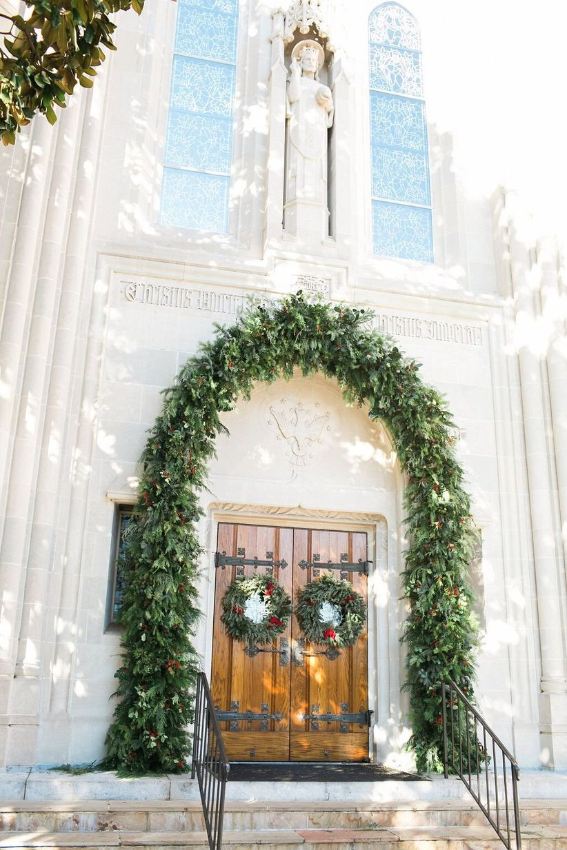 church entrance decorated with greenery