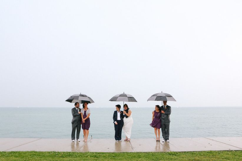 wedding party with umbrellas