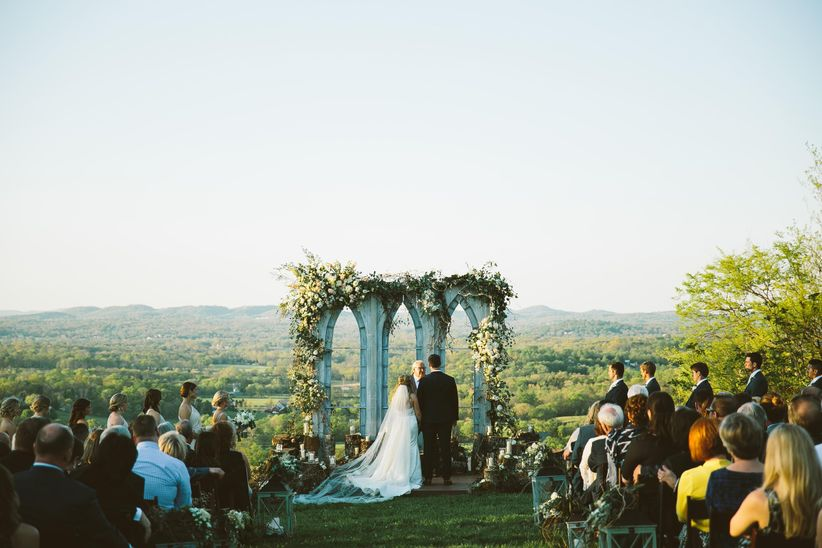 wooden stumps flowers ceremony site