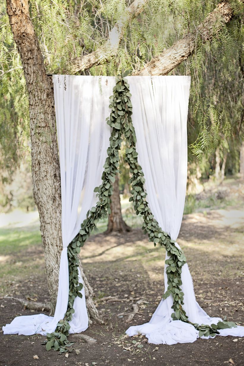 DIY ceremony backdrop with greenery garland
