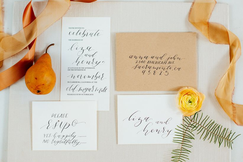 modern romantic wedding invitations with neutral color scheme and black calligraphy