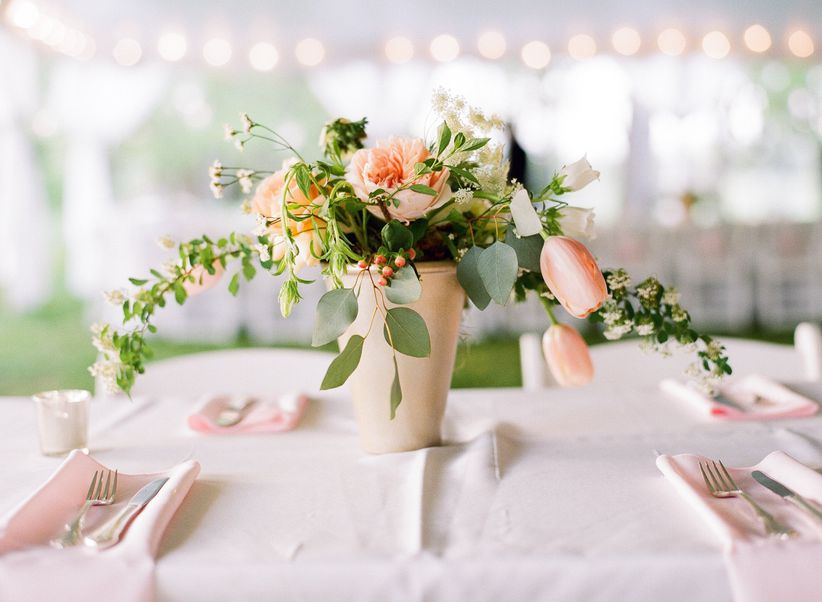spring wedding centerpiece with pink tulips, garden roses and greenery