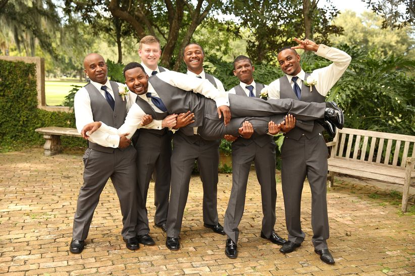 groomsmen carrying the groom - thirteenth moon photography llc
