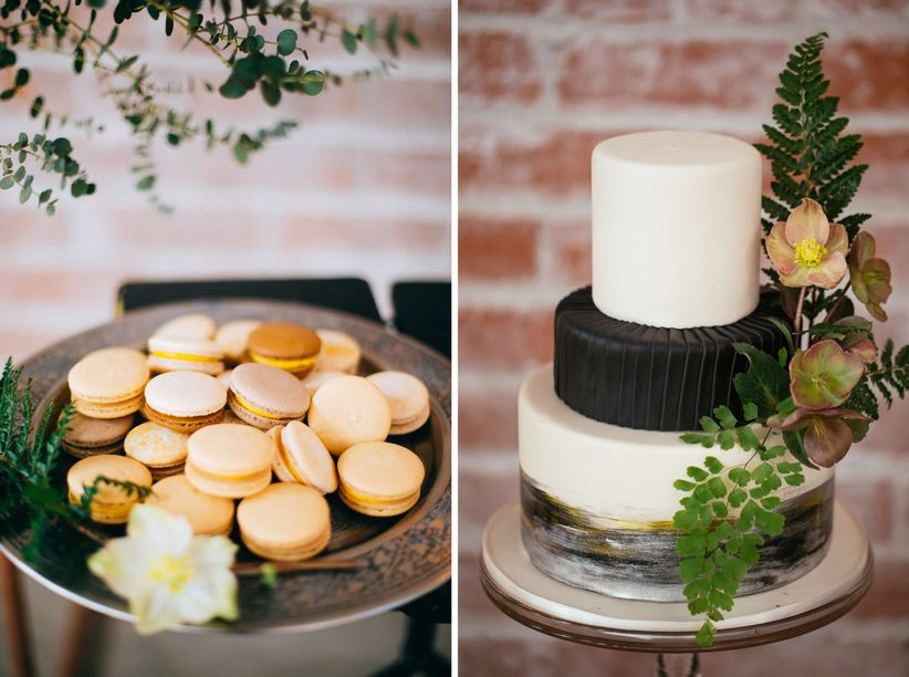 modern fondant wedding cake with black ombre color decorated with greenery and hellebores