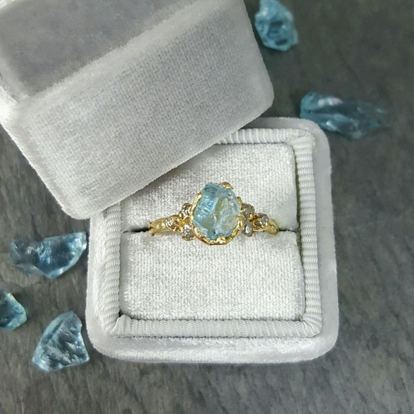 raw gemstone engagement ring in a gold setting