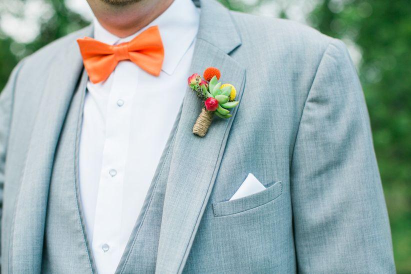 groom light gray tuxedo white button down vibrant orange bow tie succulent boutonniere