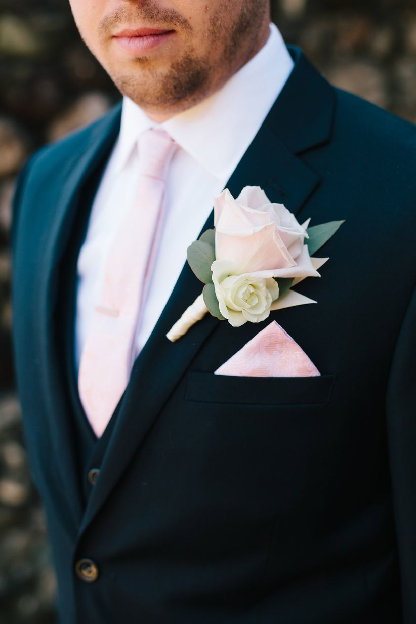 groom in navy blue three piece suit brown buttons baby pink paisley tie matching pocket square rose boutonniere silver dollar eucalyptus