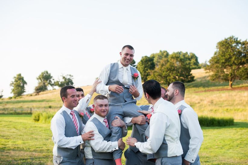 groomsmen carrying groom on their shoulders - lexi photography