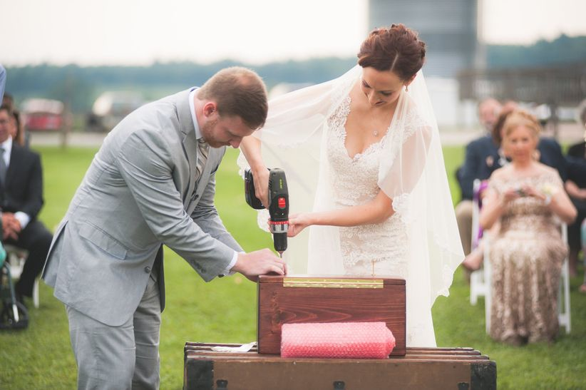 bride and groom seal love letters during ceremony <li>brit perkins photography
