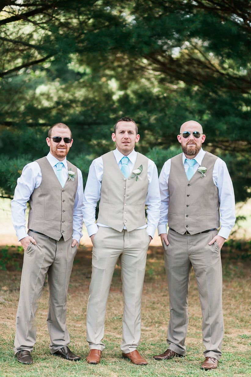 groom and groomsmen khaki slacks and vests blue button downs turquoise ties boutonniere