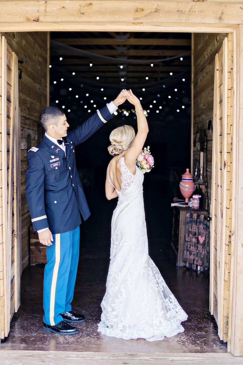 groom in army uniform twirls bride